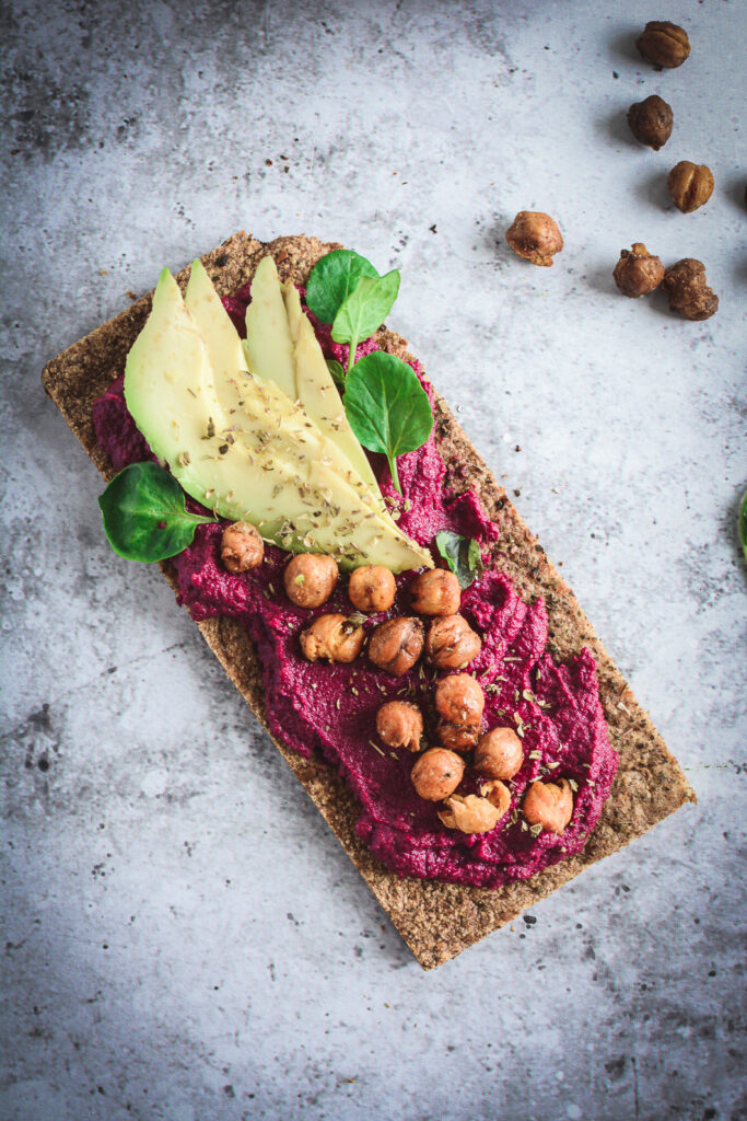 Beet Hummus on paleo flat bread topped with crispy chickpeas