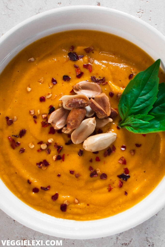 Sweet potato soup with peanuts in bowl