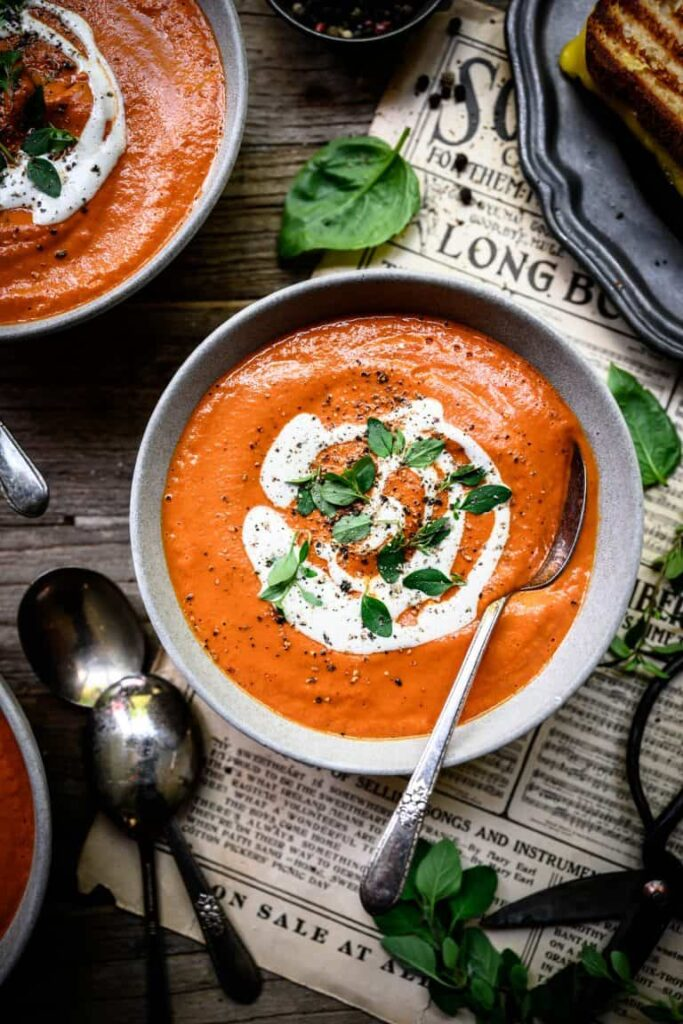tomato soup in bowl with spoons
