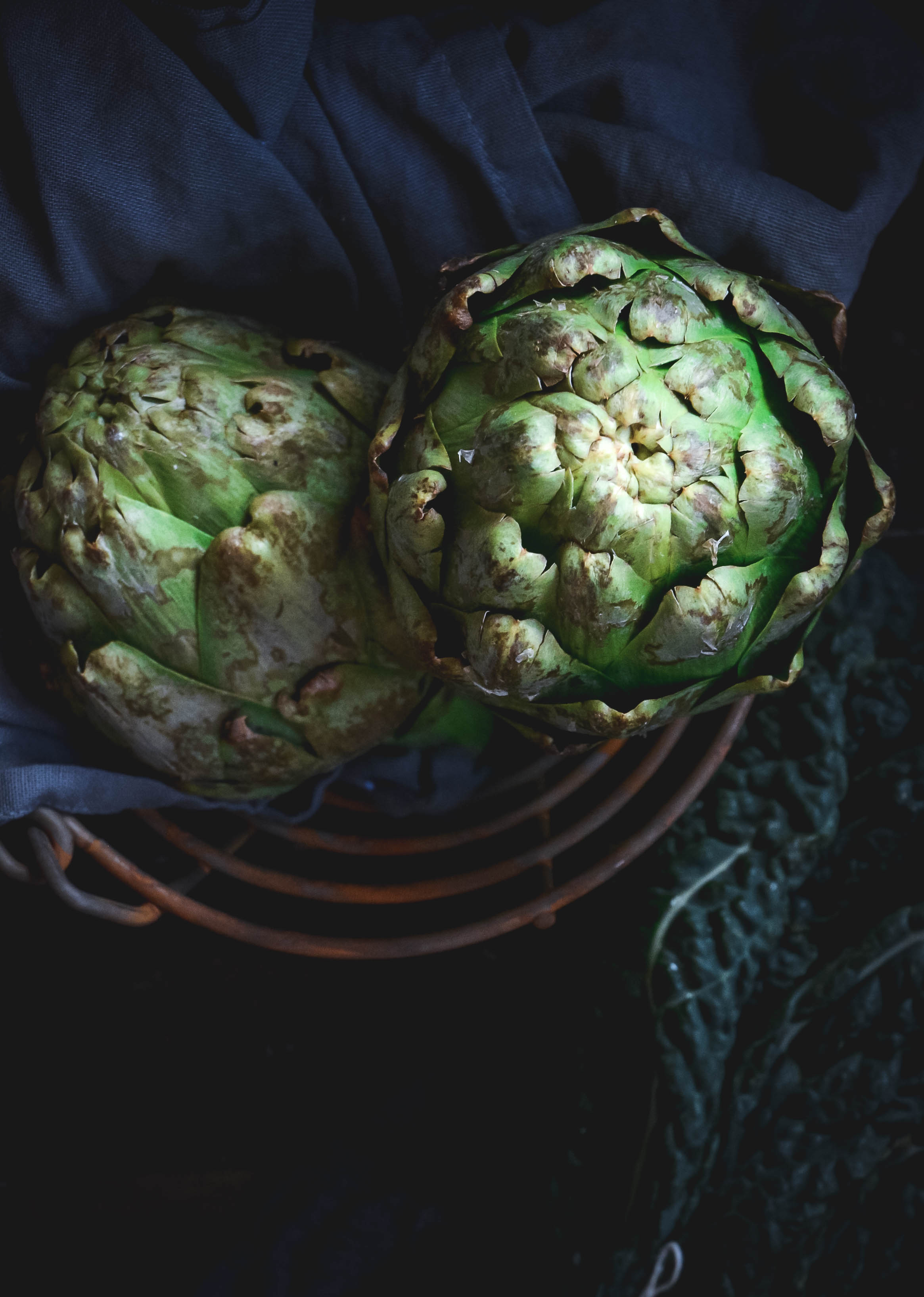 artichokes in basket with napkin