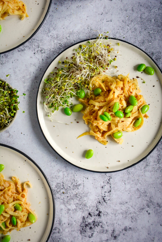 "These quick Paleo ""Peanut"" Noodles are made from rutabaga and are surprisingly similar to actual noodles. They work beautifully with the cashew and tahini sauce to create a creamy vegan and paleo recipe. Check out this 10 minute recipe! #calmeats #vegan #paleo #whole30 #paleopeanutnoodles #peanutnoodles #paleorecipes #grainfreenoodles #glutenfree #dairyfree #rutabaganoodles #tahinisauce"