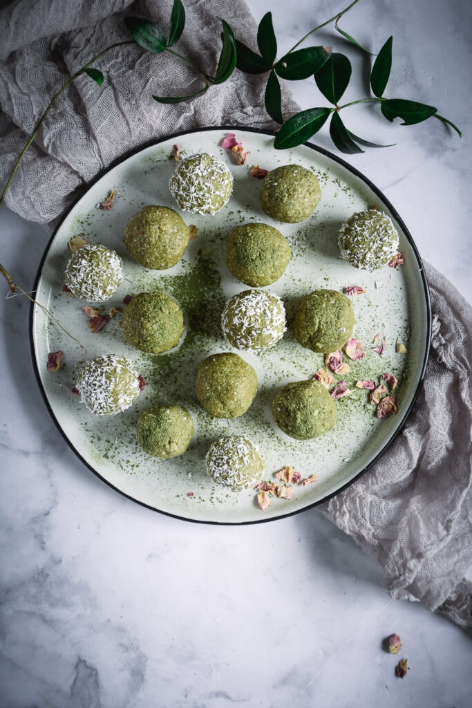 Coconut Cashew Matcha Honey Energy Bites on plate