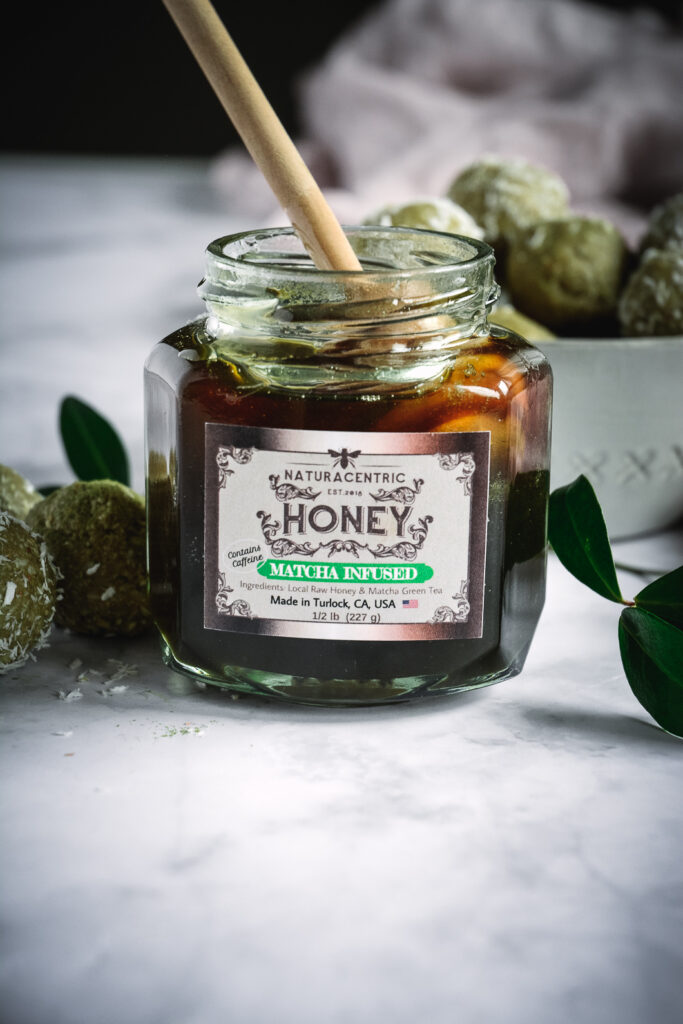 Naturacentric jar of honey with honey dipper